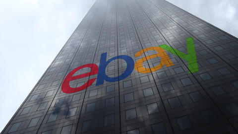 eBay Inc. logo on a skyscraper facade reflecting clouds, time lapse. Editorial Footage