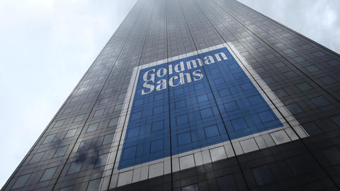 The Goldman Sachs Group logo on a skyscraper facade reflecting clouds, time Footage