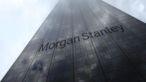 Morgan Stanley Inc. logo on a skyscraper facade reflecting clouds, time lapse Footage