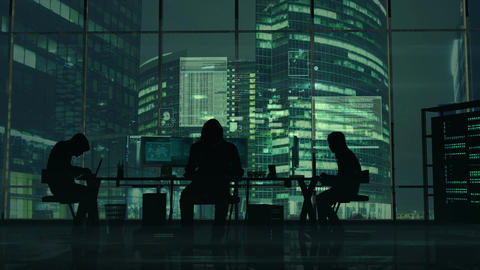Hackers at work on the background of green office buildings Animation