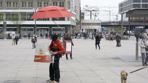 Person selling Hot Dogs at Alexanderplatz in Berlin Live Action