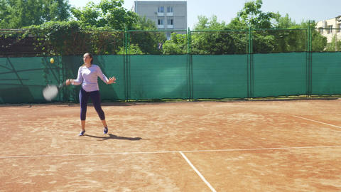 Girl playing tennis match and training to win Footage