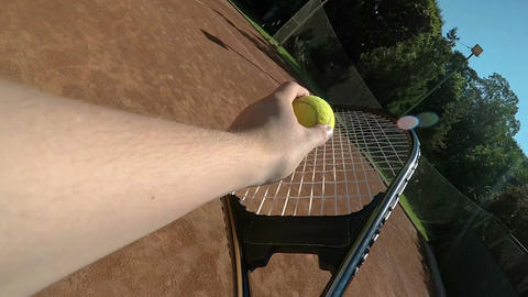 POV point of view slow motion with hand of tennis player holding racket and Footage