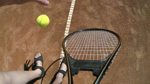 POV point of view close up with hand bouncing a tennis ball and holding racket Footage