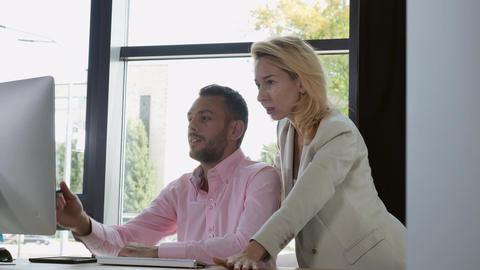 Happy man and woman at work in creative agency Footage
