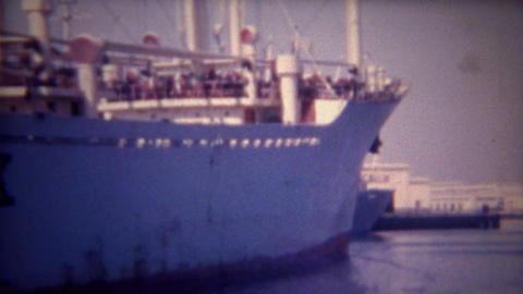1956: Marit Maersk Danish container cargo ship empty into port Footage