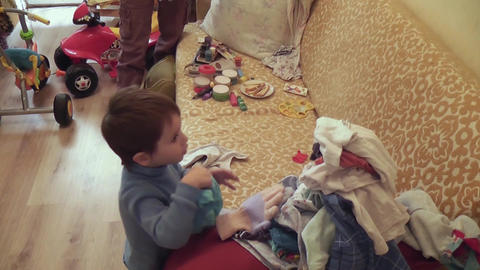 boy puts clothes Footage