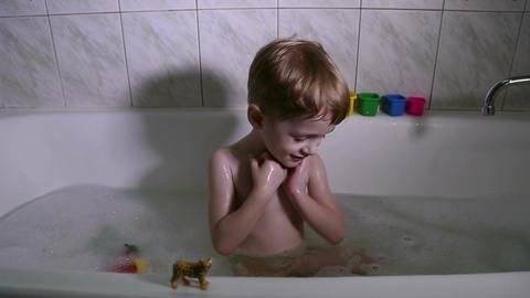 The little boy bathes in a bath with foam Footage