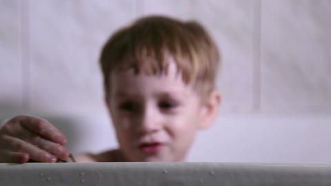 A little boy bathes and plays in the bathroom Footage