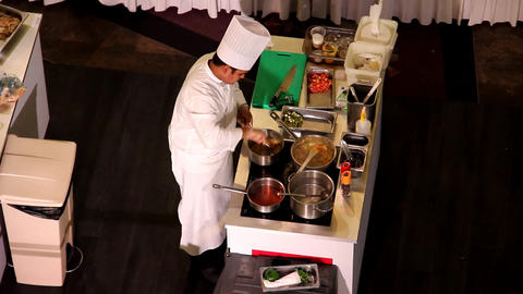 Cook make rice and vegetable, work at electric oven, cooking dishes competition Live Action