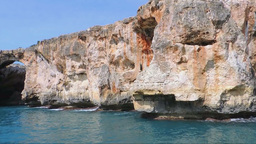 Red Cliffs With Caves Seen From The Turquoise Sea Footage