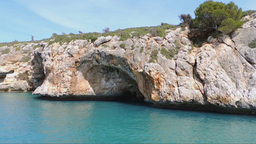 The East Coast of Mallorca Island Red Cliffs And Caves Seen From A Boat Footage