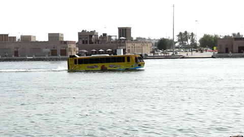 Wonder bus, floating amphibian vessel sail along Dubai Creek, pass Al Shindagha Footage