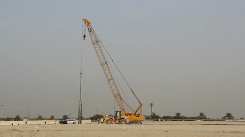 Mobile caterpillar crane slowly move, steel pipe sway at long jib Footage