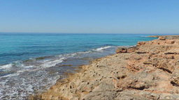 Emerald Sea, Waves Breaking Into Red Rocks Footage