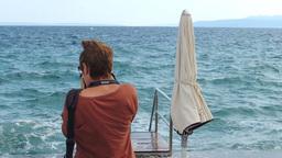 Woman shoots waves on Opatia pier Footage