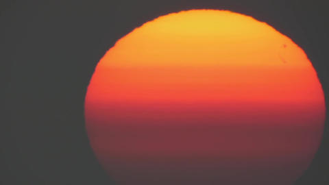 Incandescent red orb of the sun at sunrise 15 Live Action