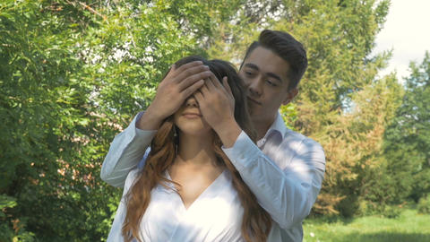 Young beautiful couple in white clothes, on a date in the park Footage