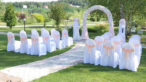 Decorated rows of chairs at the wedding ceremony Image