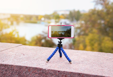 smart phone stands on a tripod Photo