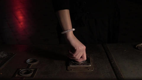 Hand Turns Knob on Industrial Machine Footage