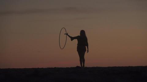 Woman Spins Hula Hoop Silhouette Footage
