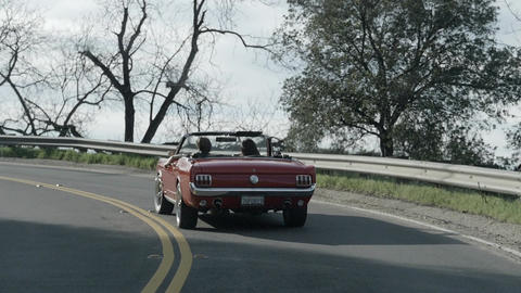 Vintage Convertible Drives on Winding Road Footage
