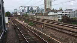 Docklands Light Railway DLR train arriving at an East London station London UK Footage