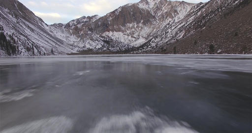 Low Angle Flight On Frozen Lake Footage