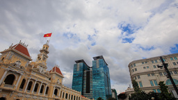 Wind Shakes Vietnamese Flag on Old Building by Skyscraper Footage