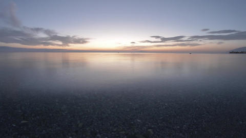 Timelapse with clouds flying over sea which float some boats anchored out at sea Footage