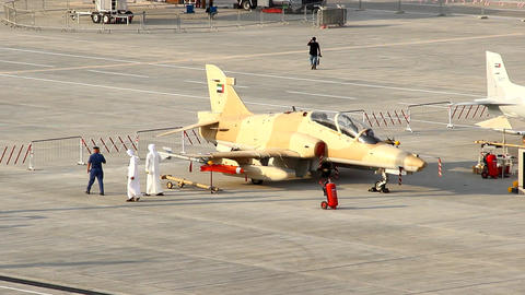 Two Arab men come beside BAE Systems Hawk aircraft at static display Live Action