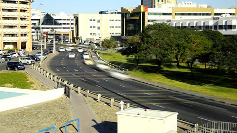 City road curve, lively traffic at sunny day, time lapse shot Footage