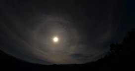 Timelapse with clouds passing over a moon hanging in the sky round 4k Footage