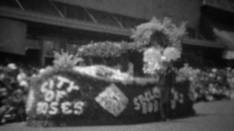 1945: City of Roses WW2 victory flower covered parade float Footage