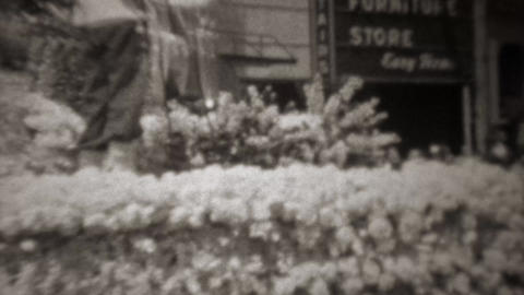 1945: Standard Oil company WW2 victory flower covered parade float Footage