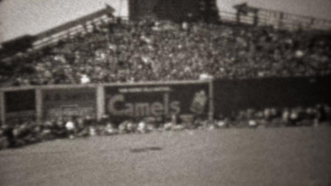 1945: Camel cigarettes advertising on baseball stadium center field Footage