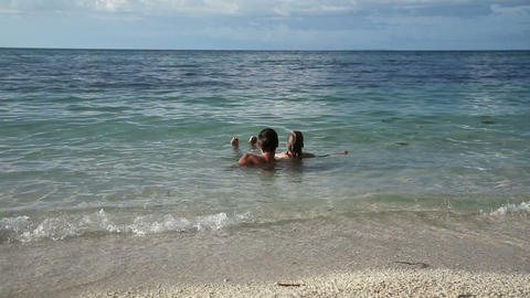 Father and daughter in the tropical sea Footage