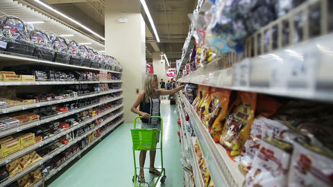 Woman in the supermarket Footage