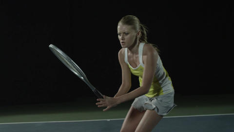 Female tennis player returns a serve in slow motion Footage