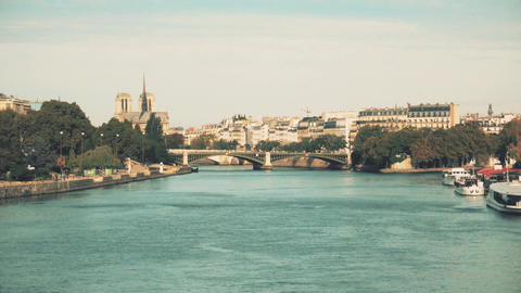 The Seine river embankments and famous Notre-Dame Cathedral Footage