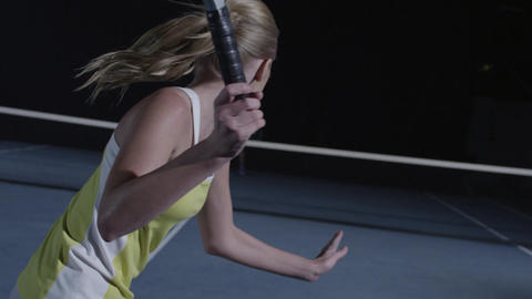 Closeup over shoulder of a woman's face playing tennis in slow motion Footage
