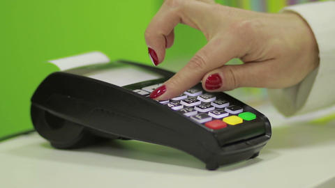Hand using bank terminal for credit card payment Footage
