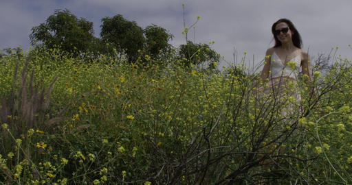 Joyful Woman Skips Through Flowers Footage