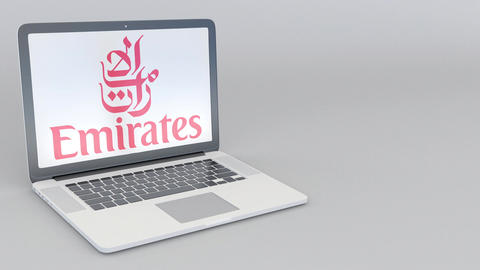 Rotating opening and closing laptop with Emirates Airline logo. Computer Footage