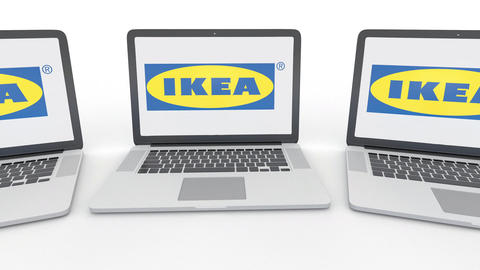 Notebooks with Ikea logo on the screen. Computer technology conceptual editorial Footage