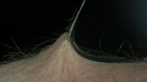 Peeling Black Tape Off a Hairy Arm Footage