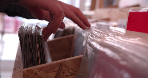 Close-up of hands sorting through records at a record shop Footage