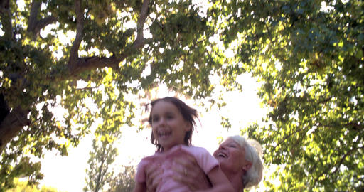 Woman throwing her granddaughter in the air and catching her Footage