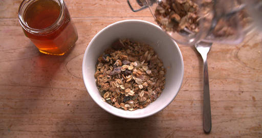 Point Of View Shot Of Pouring Muesli And Yogurt Into Bowl Footage